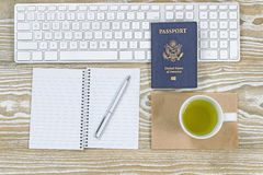Office Desktop with USA Passport and green tea Royalty Free Stock Photo