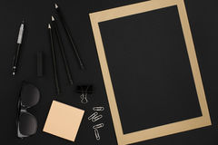 Office desktop with various black objects on  background Stock Image