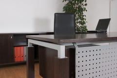 Office detail. Office desk detail in dark wood Stock Images