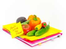 Office Documents and Vegetables; Don`t Work Too Hard Royalty Free Stock Photos