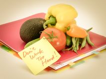 Office Documents and Vegetables; Don`t Work Too Hard Royalty Free Stock Image
