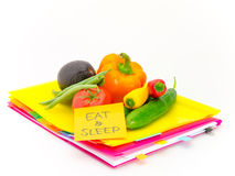 Office Documents and Vegetables; Eat and Sleep Royalty Free Stock Photo