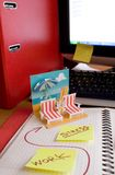 Office dream concept. Paper chaises longue on the office table and two yellow reminders with text Stress and Work stock images
