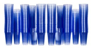 Office drinking water plastic cups. In blue and stacked in a way to suggest thirst and tower blocks Stock Images