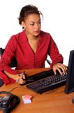 Office Ecommerce. Beautiful female executive making an online purchase in the office Stock Photography