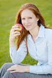 Office Employee with an Apple in a Park Royalty Free Stock Photos
