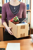 Office employee with collected in a box things Royalty Free Stock Photography