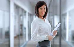 Office employee. Confident business woman employee in company office Stock Image
