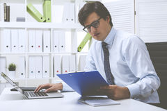 Office employee entering data into the system Royalty Free Stock Photography