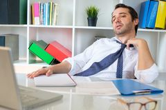 Office employee feeling stressed after summer heat haze. Businessman trying to refresh at work in summer heat Royalty Free Stock Photo