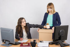 Office employee happily helps collect things sacked colleague Stock Image