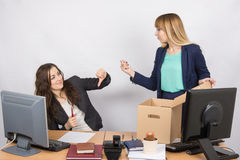 Office employee humiliating gesture of laid-off colleagues who fights back Stock Image