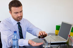 Office employee pills. Office employee taking some medicine pills stock photography