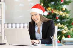 Office employee posing at workplace in christmas royalty free stock photos