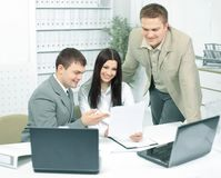 Office employees discussing documents in the office Royalty Free Stock Photos