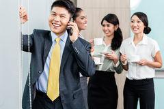 Office, employees gossiping Stock Images