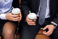 Office employees are holding coffee. Office employees are holding cups of coffee Royalty Free Stock Photos