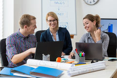 Office employees talking Royalty Free Stock Photos