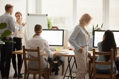 Office employees working together, businesspeople group teamwork. Office employees working together, corporate team staff using computers and talking in royalty free stock photos