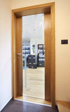 Office entrance. Entrance of an office, view through wooden door on office interior Stock Image
