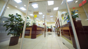 Office entrance area of bank. With reception counter; light room Stock Photo