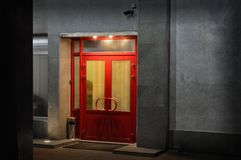 Office entrance with security system. Office entrance equipped with security system at night Royalty Free Stock Photography