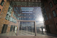 Office entrance in glass. Steel and bricks Royalty Free Stock Photos