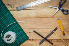 Office equipment or diy tools on wood board Royalty Free Stock Photography
