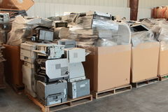 Office Equipment And Other Electronic Waste. Office equipment and other e-waste sorted, stacked, boxed, and ready for recycling royalty free stock image
