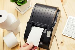 Office equipment, A point of sale receipt printer printing a receipt.  royalty free stock photos