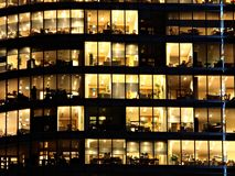 Office. Evening work in a modern office building royalty free stock photos