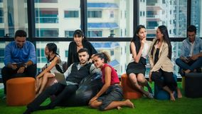 Office executives having relax in different manner. In office stock photos