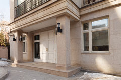Office facade, entrance doors group. Of a new contemporary office building with square columns. Side view Stock Images