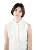 An office female isolated on a white background. A sad lady. A disappointed woman. A brunette girl wearing casual clothes. stock photos