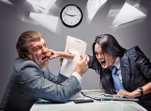 Office fight. Two office workers starting to fight Royalty Free Stock Images
