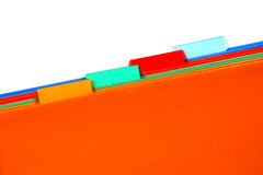 Office File Folders with Empty Blank Tabs for Text. Assorted colors orange, green, red and blue office file folders with blank copy space on tabs over white Royalty Free Stock Images