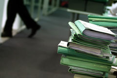 Office Files. A stack of pending files on an office desk Royalty Free Stock Photography