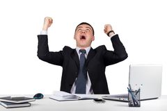 Happy young  businessman with his arms raised up isolated on white background Royalty Free Stock Photo