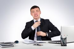Frustrated businessman screams and pulls at his tie. Office, finances, internet, business, success and stress concept-Frustrated businessman screams and pulls at Royalty Free Stock Photography