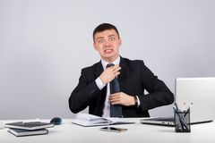 Frustrated businessman screams and pulls at his tie. Office, finances, internet, business, success and stress concept-Frustrated businessman screams and pulls at Stock Images