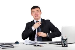 Frustrated businessman screams and pulls at his tie. Office, finances, internet, business, success and stress concept-Frustrated businessman screams and pulls at Stock Photography