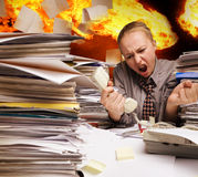 Office on fire and flying paper sheets Stock Images