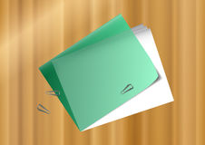 Office folder. Green office folder with papers and paperclips on wooden background Royalty Free Stock Images