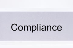 Office folder with the label compliance on white Royalty Free Stock Photos