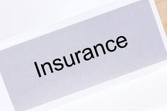 Office folder with the label Insurance Stock Photos