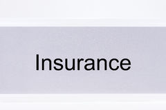 Office folder with the label Insurance Stock Image