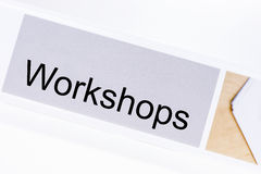 Office folder with the label workshops Stock Image