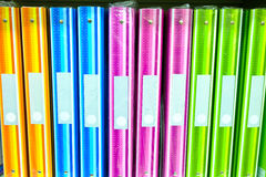 Office folder on the shelves of documents. File folders, standing on the shelves in the background Stock Photography