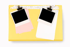 Office file folder with untidy notepaper and two blank polaroid photo prints. Office folder with untidy note paper and blank polaroid instant camera photo print Stock Image