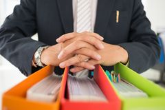 Office folders. Close-up of the chief with office folders Royalty Free Stock Photos